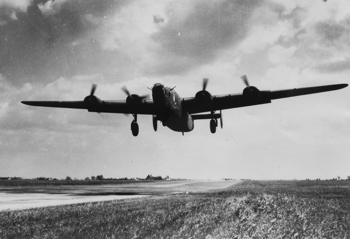 "A B-24 Liberator nicknamed ""The Tweachewous Wabbit"" of the 487th Bomb Group takes off from Lavenham airfield in 1944."